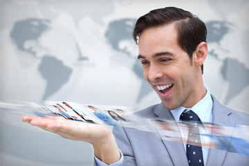 Pleased businessman looking at a picture stream