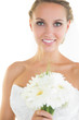Gorgeous blonde bride posing holding a bouquet