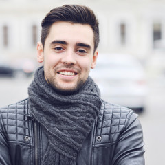 Closeup portrait of handsome smiling man - outdoors