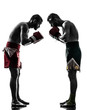 two men exercising thai boxing salute  silhouette