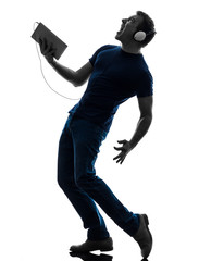 man listening music  digital tablet  silhouette