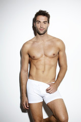 Attractive bare-chested male in underwear