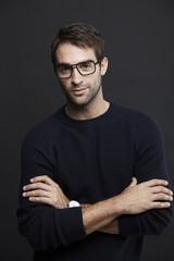 Portrait of mid adult man in glasses, studio