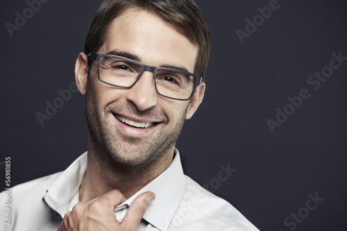 Portrait of mid adult man wearing glasses, laughing