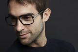 Mid adult man wearing glasses, studio shot