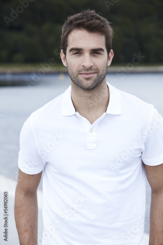 Portrait of mid adult man in white shirt