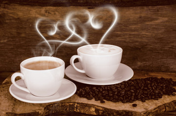 Coffee beans and coffee cup with heart- shaped steam
