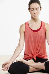 Young active woman doing yoga