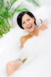 Woman taking a bath with suds  and relaxes