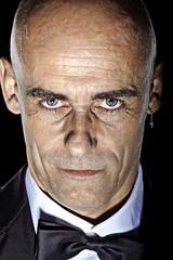 Intensive Close-up bold mature man portrait color image