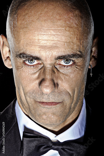 Intensive Close-up bold mature man portrait color image