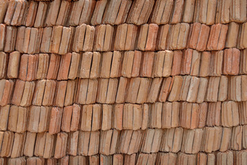 Stack new tile for roof.