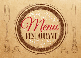 Menu restaurant lettering on a plate with a fork and a spoon on