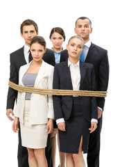 Group of business people tied with rope, isolated on white