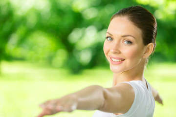 Portrait of woman with outstretched arms working out