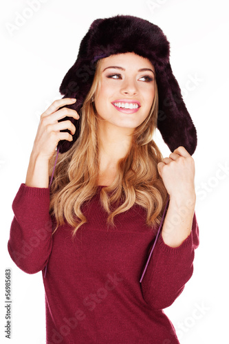 Beautiful woman in a winter cap