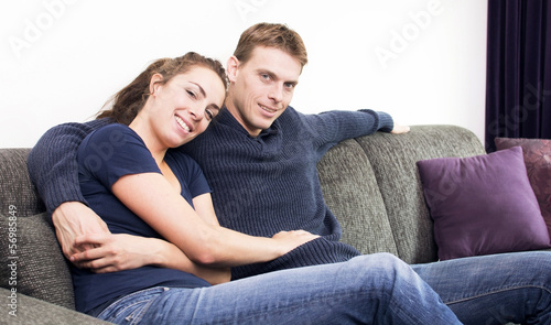 Happy couple on couch