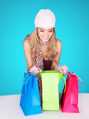 Beautiful female shopper checking her purchases