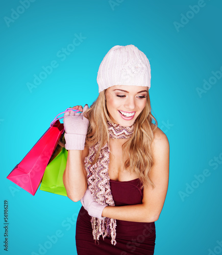 Smiling stylish woman with shopping bags