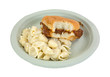 A bitten barbecue pork sandwich with pasta on a paper plate