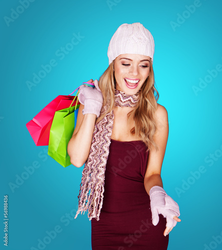 Joyful young woman with shopping bags