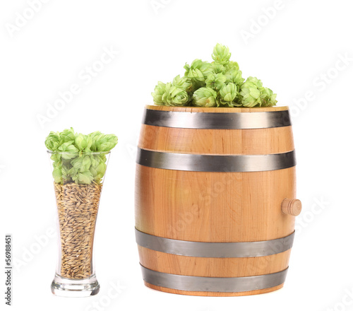 Barrel and glass with hop barley.