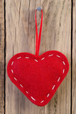 Heart decoration hanging against wooden background