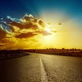 dramatic sunset over road to horizon