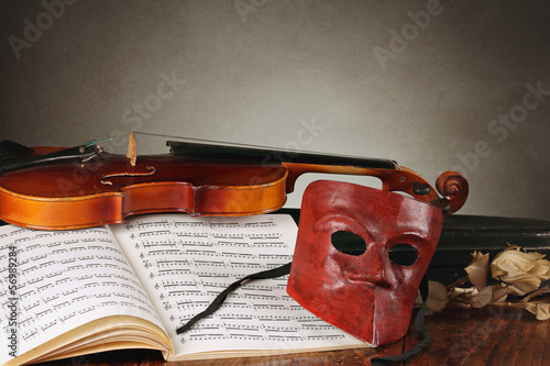 Venetian mask with old fiddle composition