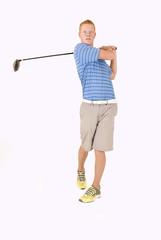 Tall redhead young man teeing off with driver and white backgrou