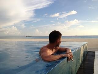 Man at beach pool