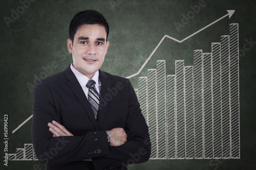 Asian businessman with growing graph