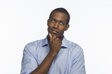 African American man thinking and looking sideways, horizontal