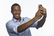 Young African American man taking selfie picture, horizontal