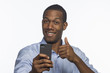 Young African American man taking picture with smartphone