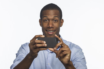 African American man taking picture with smartphone