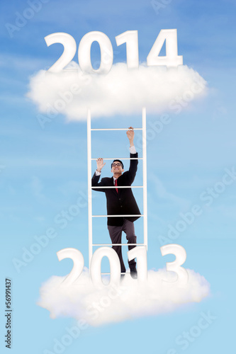 Businessman try to climb upward