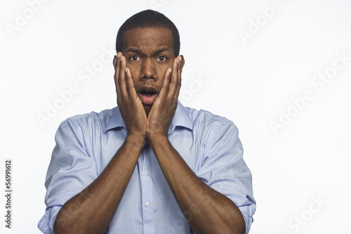 Young African American man surprised, horizontal