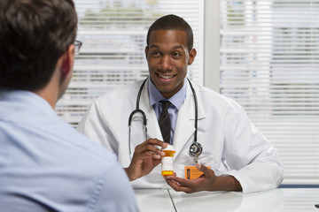 African American doctor holding prescription, horizontal