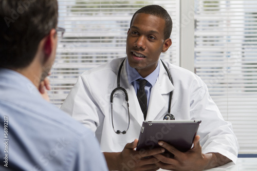 African American doctor with tablet and patient, horizontal