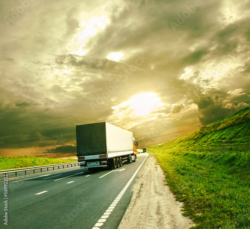 trucks under colorful sky