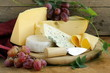 canvas print picture - cheeseboard (Maasdam, Roquefort, Camembert) and grapes