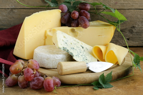 canvas print picture cheeseboard (Maasdam, Roquefort, Camembert) and grapes