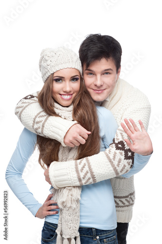 young smiling couple in winter clothing embracing