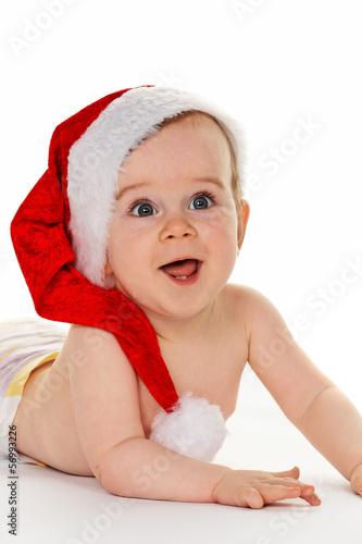 Kind mit Weihnachtsmann Mütze