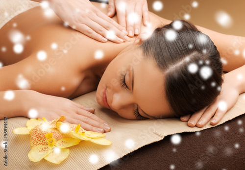 woman in spa salon getting massage