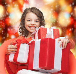 happy child girl with gift boxes