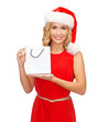 woman in red dress with shopping bag