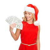woman in santa helper hat with us dollar money