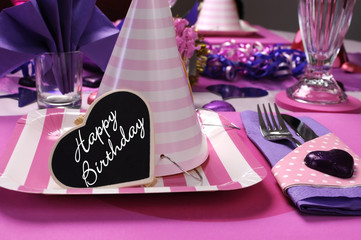 Pink & purple theme party table setting wth party hat